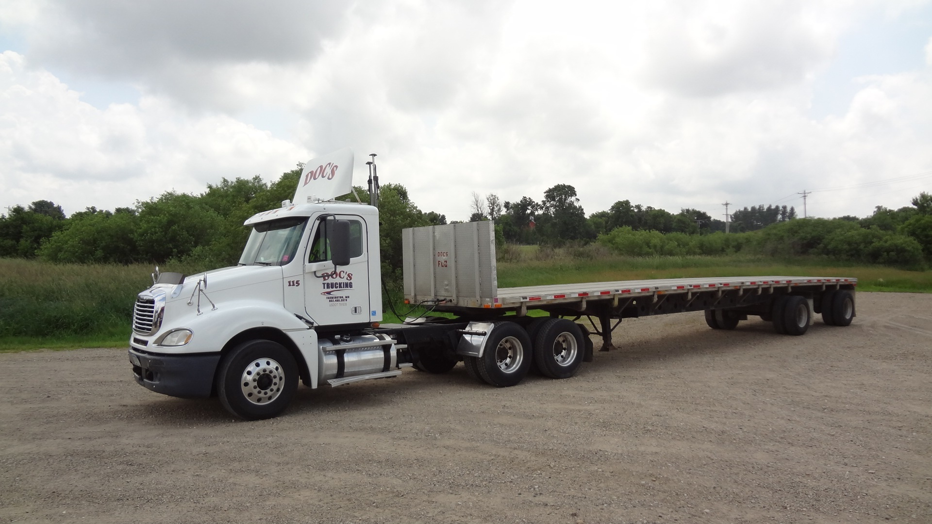Tractor semi truck with flatbed trailer minnesota